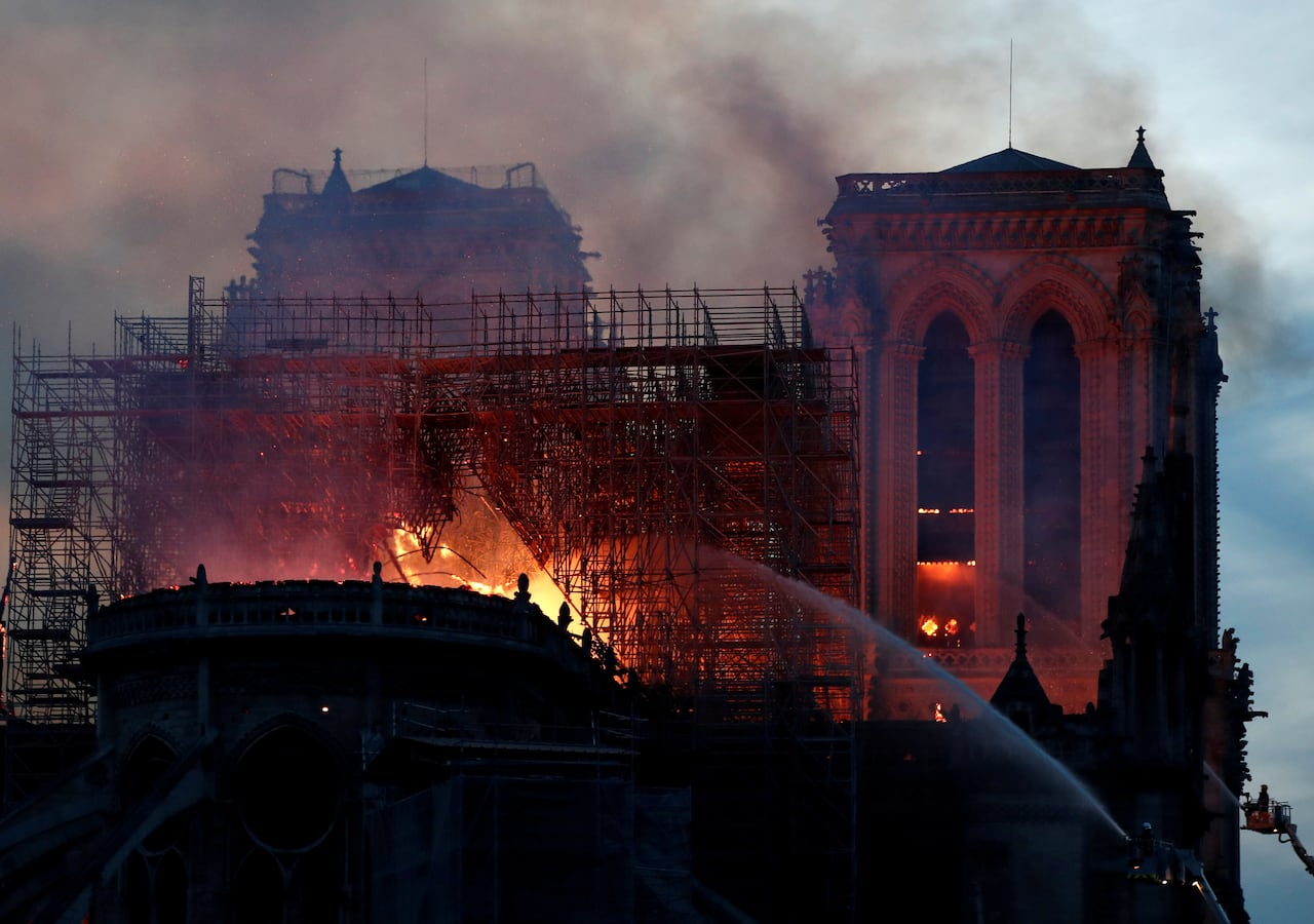 Macron Promises To Rebuild Notre Dame Cathedral After Fire Seeks