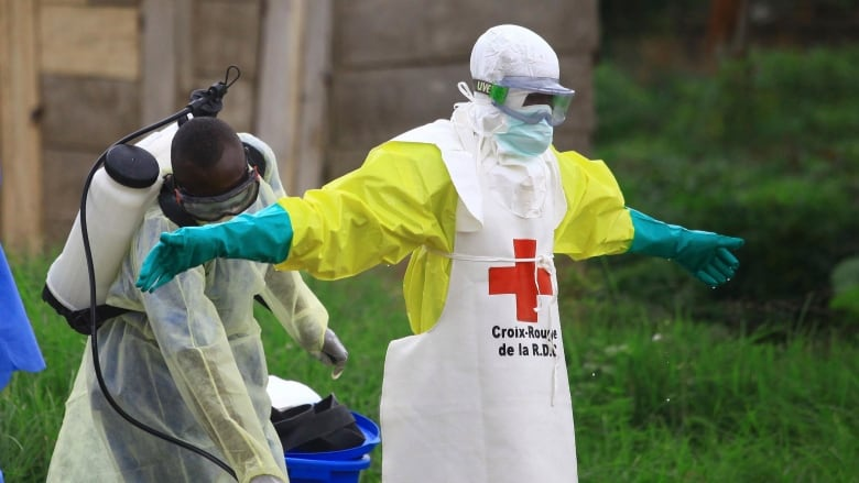 How mistrust and fear make fighting Ebola more difficult