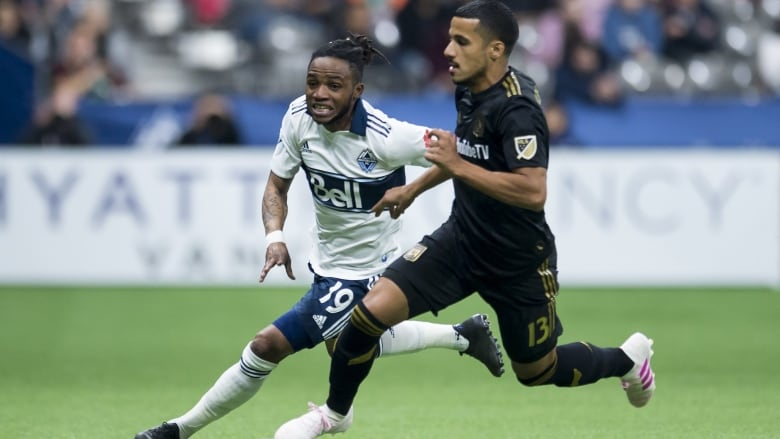 b10a5b7ed Vancouver Whitecaps forward Alhassane Bangoura, left, fights for control of  the ball with Los Angeles FC defender Mohamed El-Munir during the second  half in ...