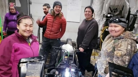 Friends, bonding and a lot of grease at women's snowmobile repair course
