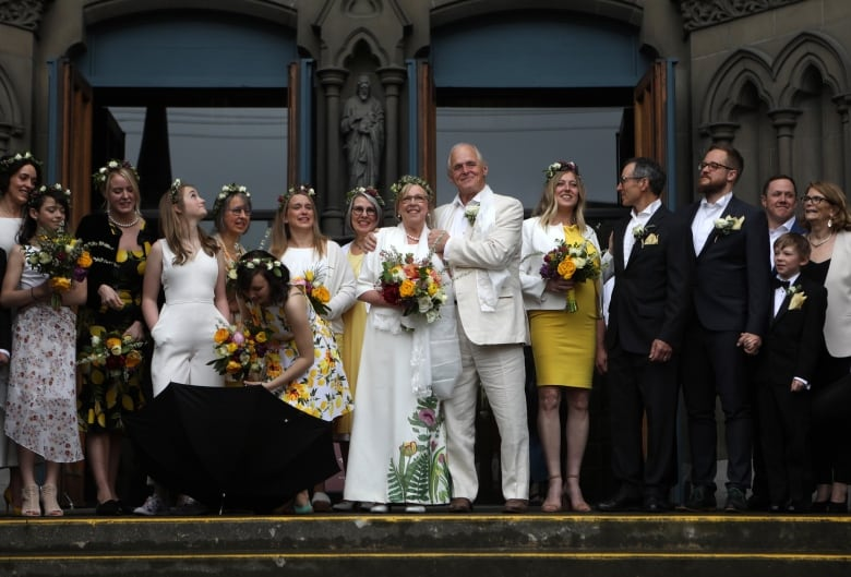 aeff1e2cd0b Elizabeth May and John Kidder s wedding party on the front steps of the  Christ Church Cathedral in Victoria