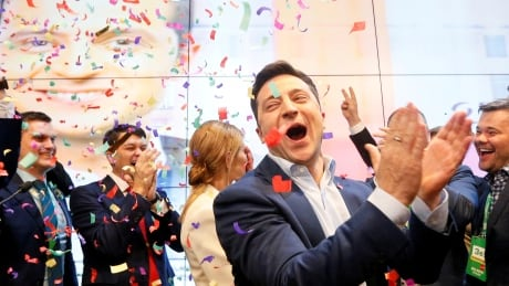 Ukraine's new comedian president gets hopeful welcome at home, chill from Putin