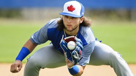 Blue Jays prospect Bichette hit by pitch, breaks left hand: reports
