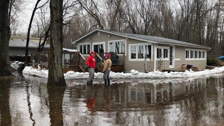 Flood tired communities in Ontario, Quebec brace for more rain