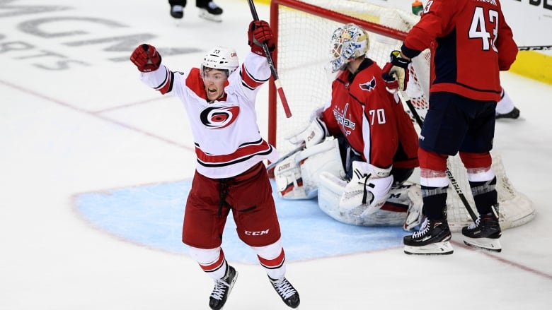 899f1f6858c110 Carolina s Brock McGinn celebrates after scoring the game-winning goal in  double-overtime to give the Hurricanes a 4-3 win over the Washington  Capitals in ...