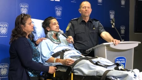 Police bring severely injured man into media studio to make appeal to hit and run driver