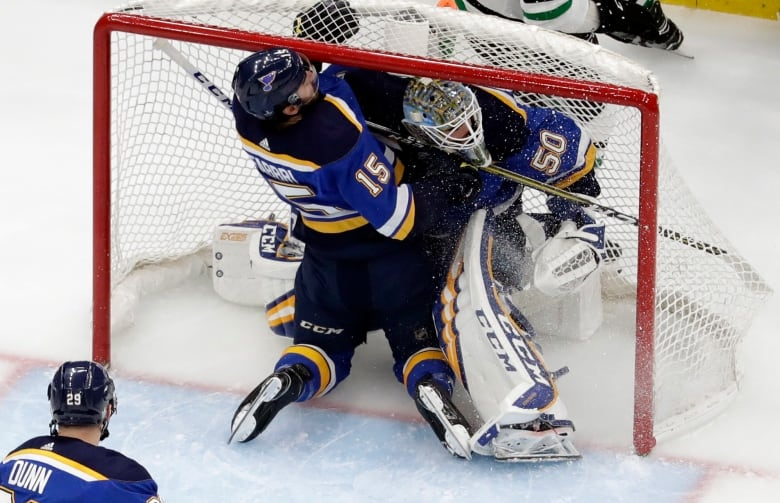 Blues escape wild third period with a 2-1 series lead