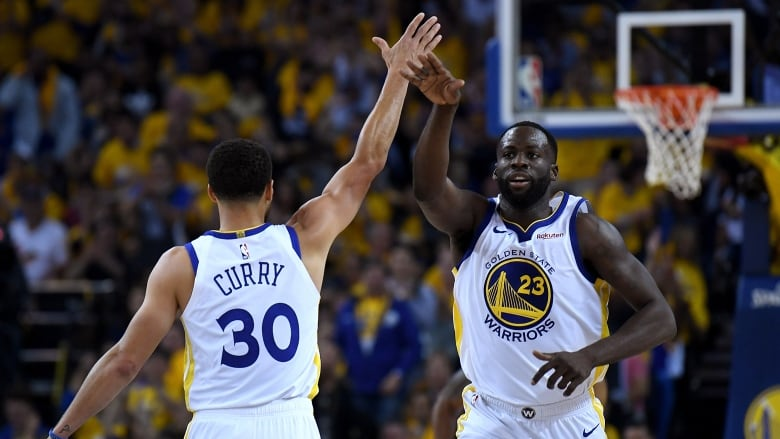 7c0e45216 Golden State s Stephen Curry and Draymond Green celebrates a slam dunk  during the Warriors  104-100 win over the Houston Rockets in Game 1 of  their ...