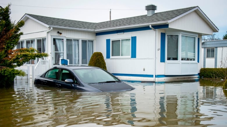 Quebec won't permit reconstruction of worst-hit homes in flood zones