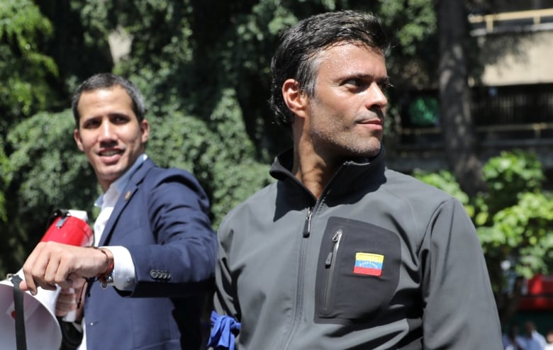 Venezuelan opposition activist Leopoldo Lopez, right, went to the Spanish Embassy in Caracas following Tuesday's attempted military uprising. (Manaure Quintero/Reuters)