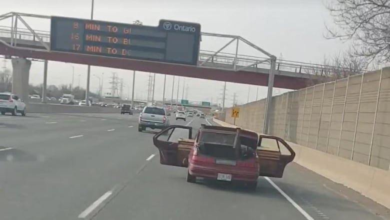 Qew Driver Caught On Video With Car Doors Open Carting Load
