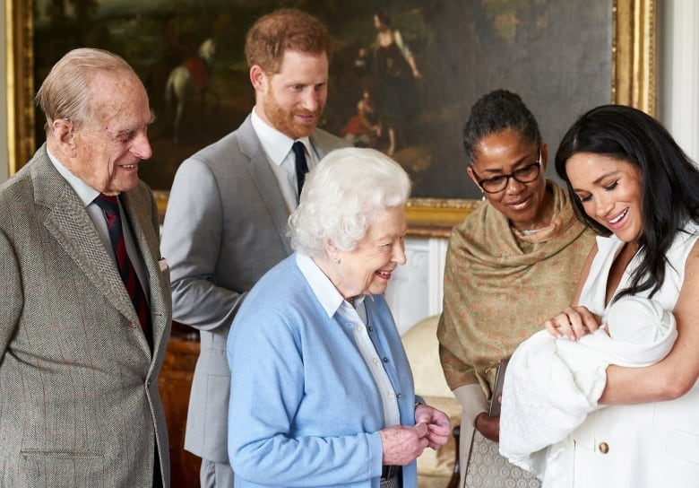 974574d75 Prince Harry, second from left, and wife Meghan, right, show their son  Archie to the Queen and Prince Philip, left, along with Meghan's mother, ...