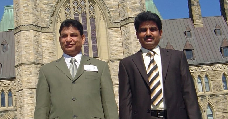 Peter Bhatti of Brampton, Ont., left, with his brother, Shahbaz, during a visit to Parliament Hill. Shahbaz, who was a Christian federal minister in Pakistan, was killed after speaking out against the country's blasphemy laws. (David Bhatti)