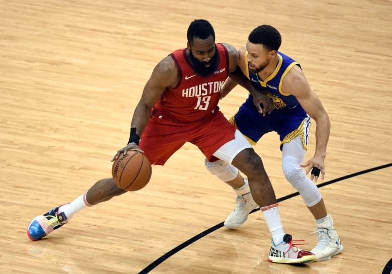 fb8d5b2d5ea5 Houston Rockets  James Harden (13) works against Golden State Warriors   Stephen Curry during the second half of Game 6. (Christian Smith The  Associated ...