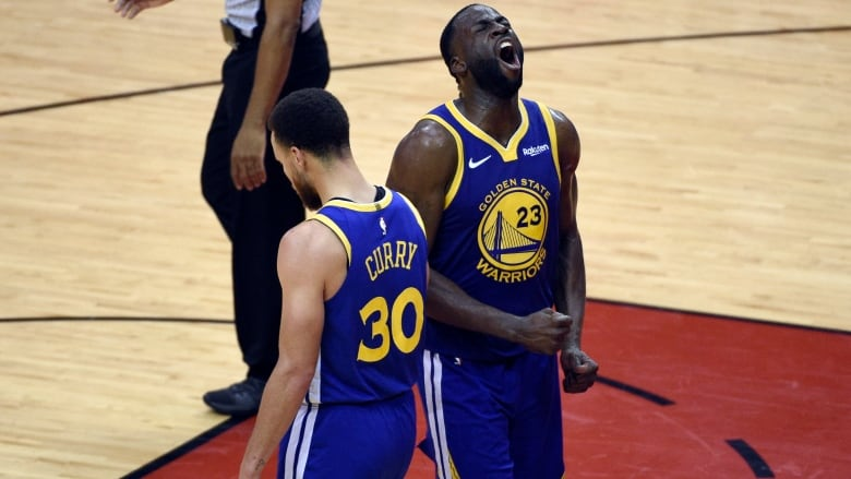 3b61ff0eb713 Golden State Warriors  Draymond Green (23) and Stephen Curry (30) celebrate  in the closing seconds of Game 6. (Eric Christian Smith The Associated  Press)