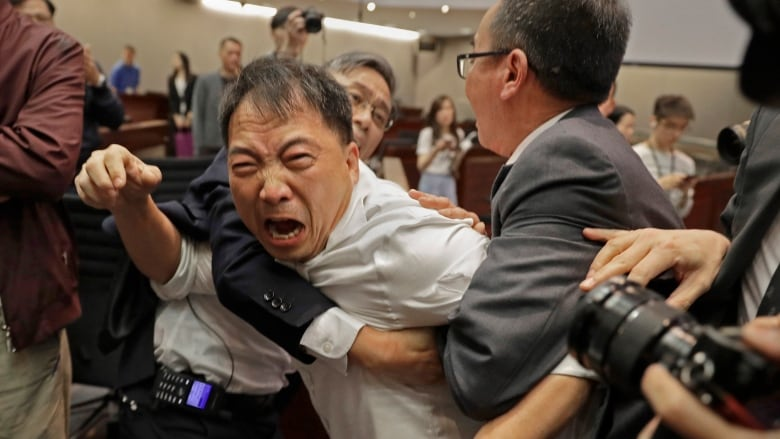 Hong Kong legislators brawl over contentious extradition law