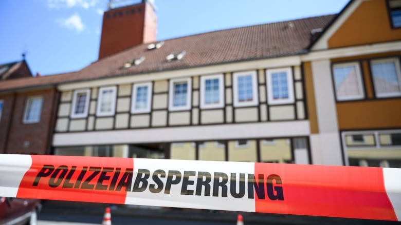 Three people shot with crossbow found dead in German hotel