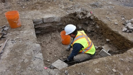 Worker Digging Excavation site east of Centre Block
