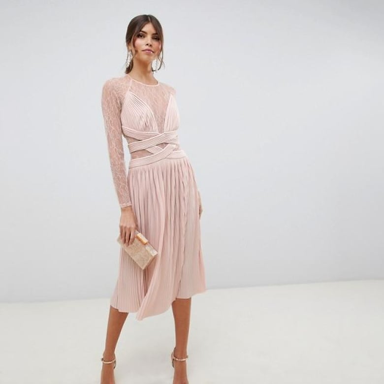 a86d7f5e6 There are many things to love about this dress: the colour, the lace and  the criss-cross detailing. Since there's a lot of detail that demands  attention, ...