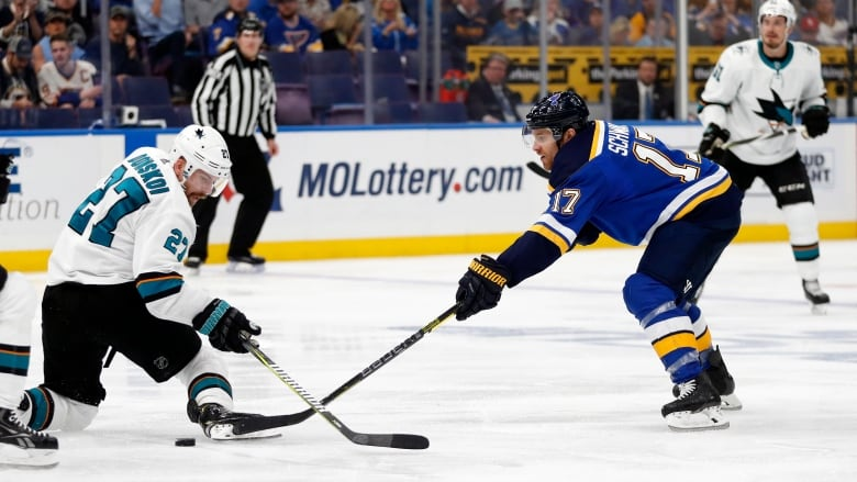 new concept 1f162 e8836 St. Louis Blues left wing Jaden Schwartz tries to move the puck past San  Jose Sharks right wing Joonas Donskoi during the second period in Game 4 of  the NHL ...