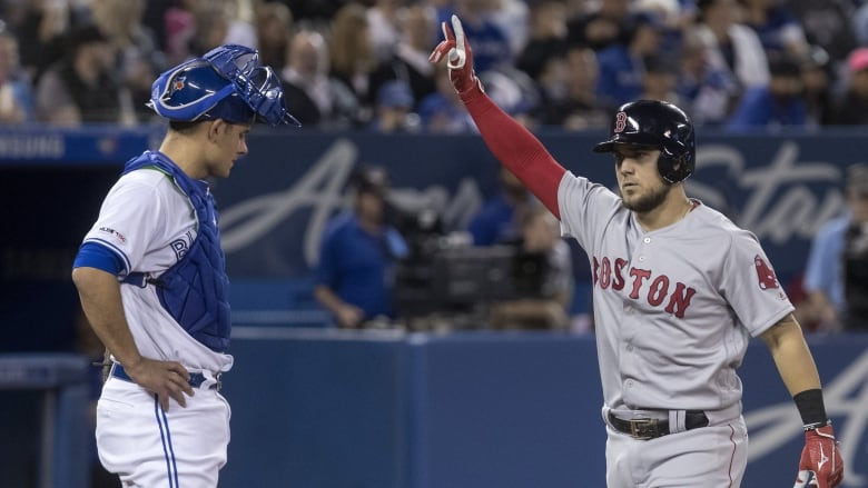 fa8e3747a Boston s Michael Chavis crosses home plate in front of Toronto catcher Luke  Maile after hitting a two-run homer run in the third inning on Monday.