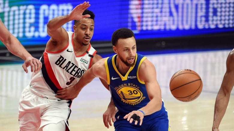 84408cb5883 Golden State's Stephen Curry battles for the ball with Portland's CJ  McCollum during the second half in Game 4. (Steve Dykes/Getty Images)