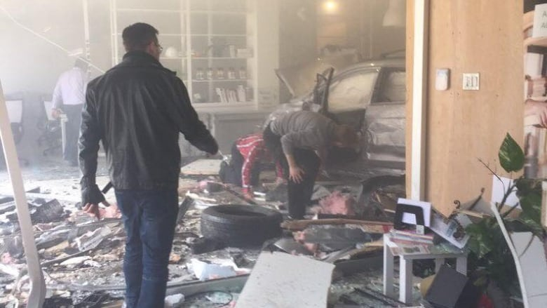 Car crashes into building in downtown Quebec City, bursts into flames