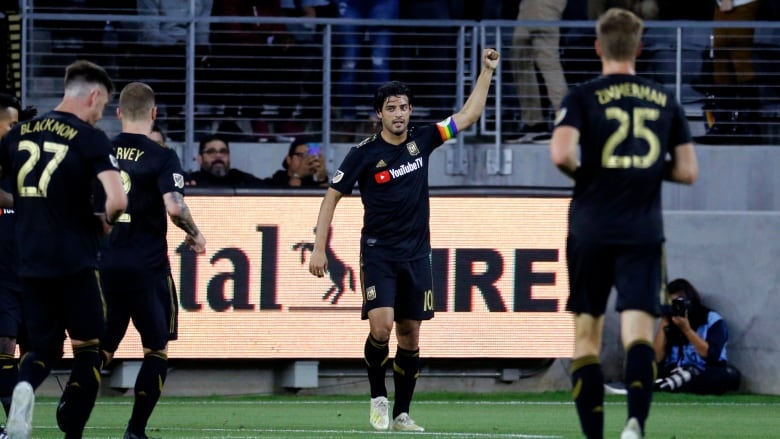 5090c0b6722 Los Angeles FC forward Carlos Vela (10) celebrates his goal against the  Montreal Impact during the first half. (Ringo H.W. Chiu/The Associated  Press)
