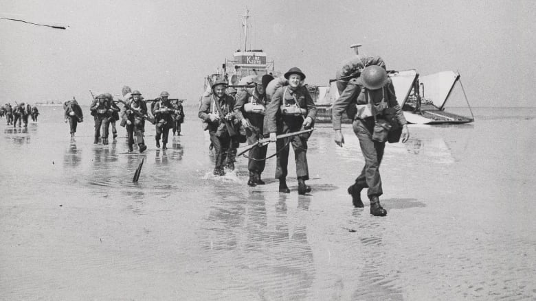 ca7b2b1975de Canadian troops land at Juno Beach, Courseulles-sur-Mer, Normandy, on June  6, 1944. (CWM 20020045-1453/George Metcalf Archival Collection/Canadian War  ...