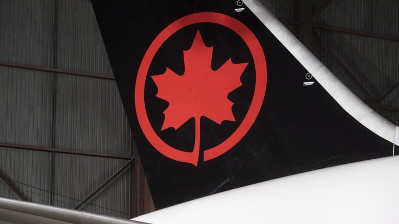 Air Canada reviewing how crew left sleeping passenger on