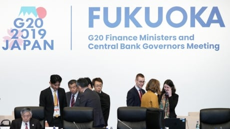 G20 finance chiefs to warn of trade risks, but differ on how 'pressing' they are