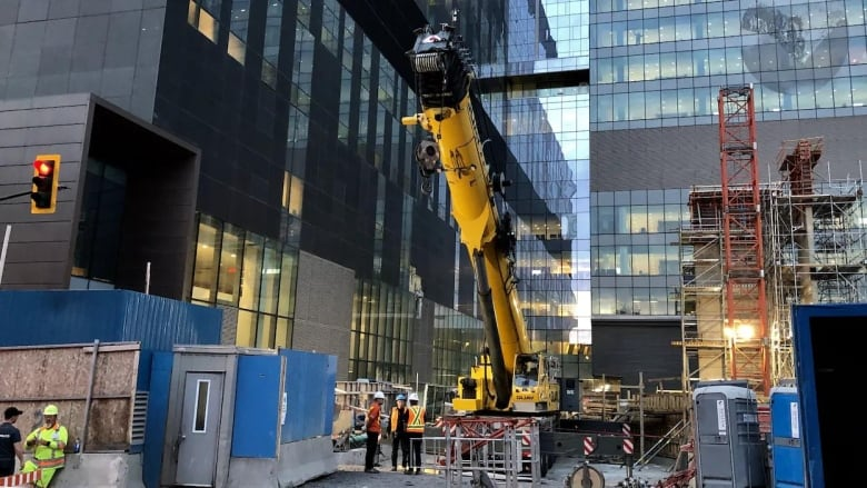 Crane smashes into Montreal's CHUM hospital, closing blood