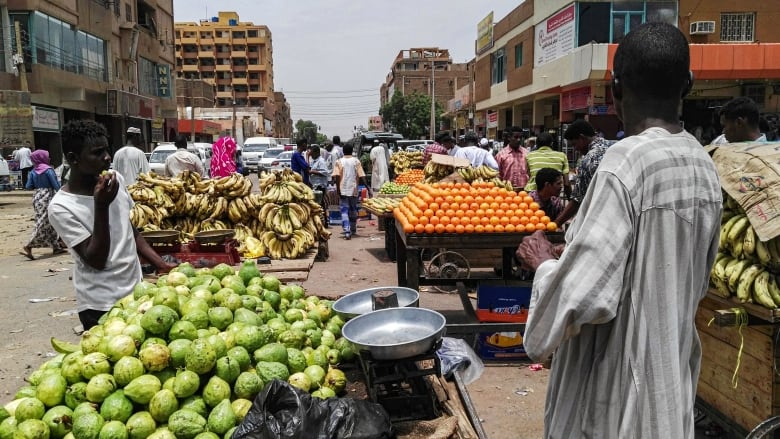 Sudanese businesses reopen as protest leaders call off