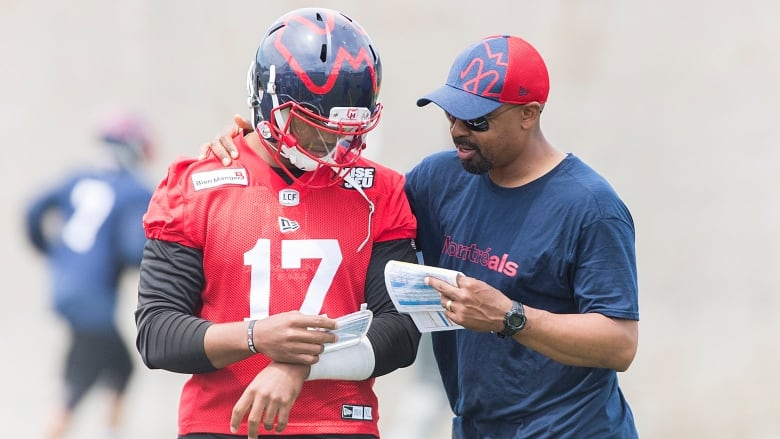 814ef2d2cd6 New Montreal Alouettes head coach Khari Jones, right, talks with  quarterback Antonio Pipkin during practice in Montreal. The Alouettes'  ownership and ...