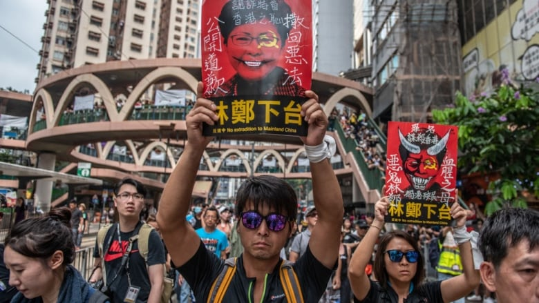 Huge crowds march in Hong Kong, piling pressure on leader to scrap extradition bill