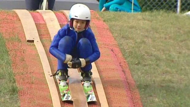 Ski jumpers use temporary ramp on Calgary hill after WinSport facility closes | CBC News