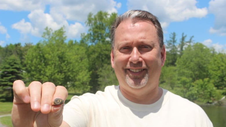 He found buried treasure, but now he's on the hunt for its owner
