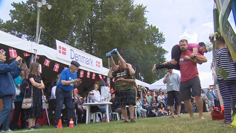 Fastest wife-carrying couple wins 45 kg of beer at Burnaby festival