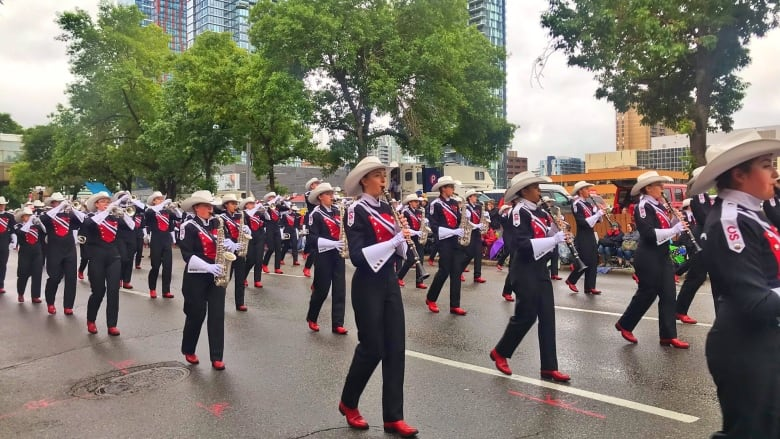 The Calgary Stampede Showband Marches Down Ninth Avenue S