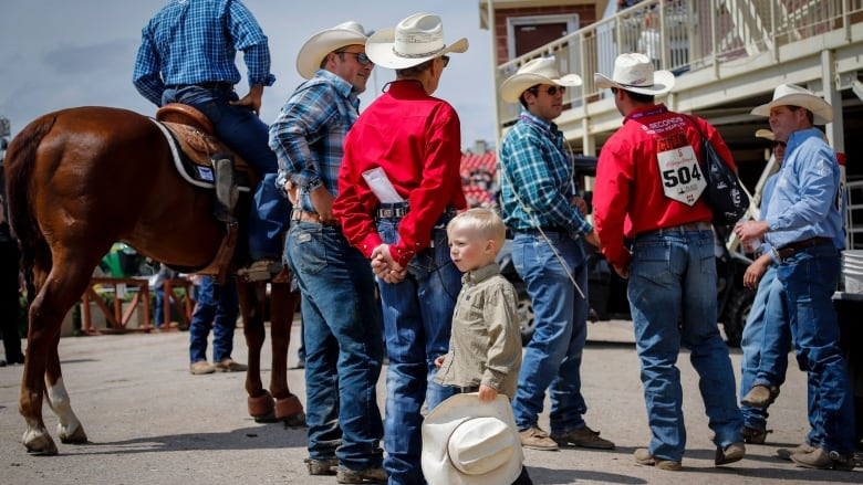 Calf Ropers Gather Before The Start Of Rodeo Action At The