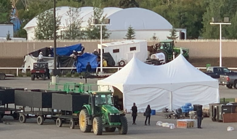 A Tarp Covers The Scene Of The Accident That Led To Three