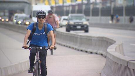 Cyclist Burrard Street Bridge bike lane Sunday 14 July 2019