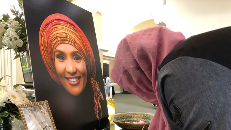 'To see the light where there was no light': Hundreds gather to remember Hodan Nalayeh