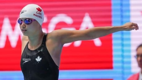 Maggie MacNeil claims 100m butterfly gold at aquatics worlds