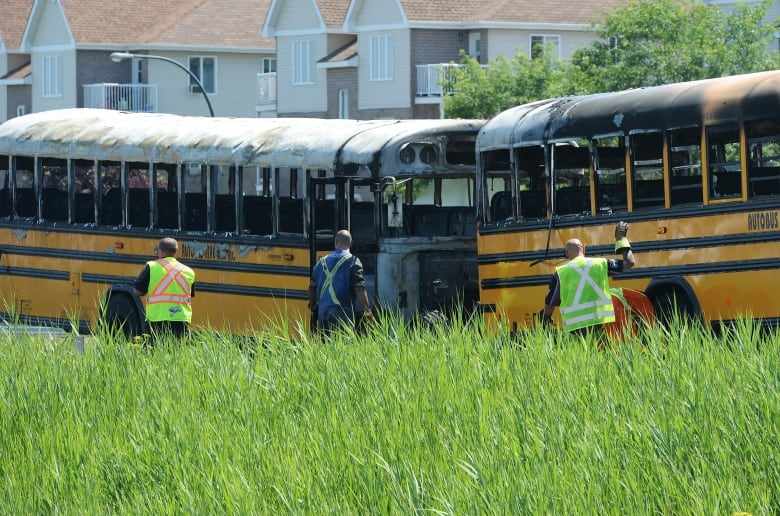 Two school buses catch fire, students sent to hospital after collision in St-Eustache, Que.