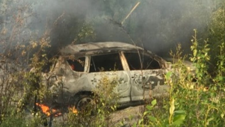 https://i.cbc.ca/1.5222926.1564007193!/fileImage/httpImage/image.jpg_gen/derivatives/16x9_780/burnt-out-car-in-northern-manitoba.jpg