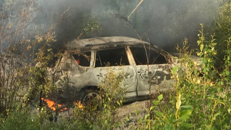 Manhunt underway after burnt vehicle found in northern Manitoba used by suspects in B.C. homicides: RCMP