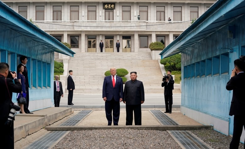 U.S. President Donald Trump and North Korean Leader Kim Jong-un stand at the demarcation line in the demilitarized zone separating the two Koreas, in Panmunjom, South Korea this June. (Kevin Lamarque/Reuters)