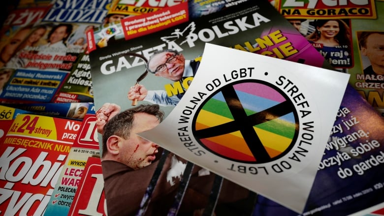 489a25cc6a02 On stickers distributed in weekly conservative magazine, Gazeta Polska,  this week, the phrase 'LGBT-free zone' circles a rainbow with a cross  through it.
