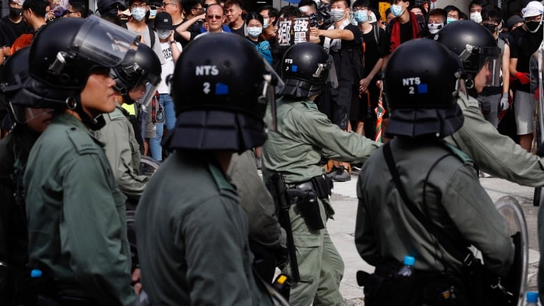 Hong Kong police fire tear gas, use batons after protesters
